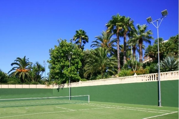 The spacious, private tennis court
