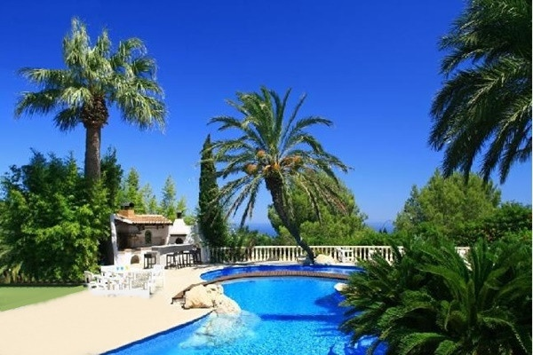 The paradise-like outdoor-area with heavenly barbados-blue pool