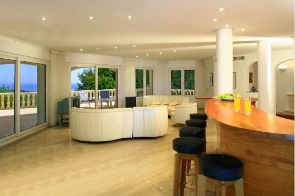 The exclusive living room with its own bar and gorgeous interior